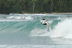 Surfer on tropical wave, Indonesia Royalty Free Stock Photo