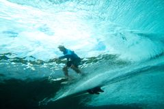 Surfer on tropical wave underwater vision royalty free stock image