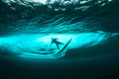 Surfer on tropical wave underwater vision. Underwater view of surfer and crystal clear wave Royalty Free Stock Photos