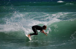 Surfer turning on a wave Royalty Free Stock Photography