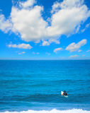 Surfer waiting for the wave. Under a huge cloud Royalty Free Stock Photos