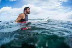Surfer waits the wave on line up. With surf board Royalty Free Stock Photos