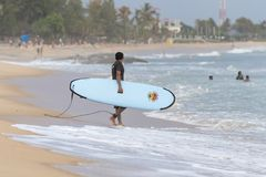 Surfer walking on the beach. To the sea in Arugam Bay, Sri Lanka. Arugam Bay is the hotspot in Sri Lanka and probably one of the best places in the world to Stock Photography