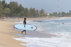 Surfer walking on the beach. To the sea in Arugam Bay, Sri Lanka. Arugam Bay is the hotspot in Sri Lanka and probably one of the best places in the world to Stock Images