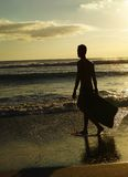 Surfer walking on beach Royalty Free Stock Images