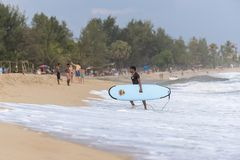Surfer walking out of the water. Surfer walking out of the sea with his surf board in Arugam Bay, Sri Lanka. Arugam Bay is the hotspot in Sri Lanka and probably Royalty Free Stock Photography