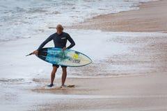 Surfer Walking on Sunset Beach Hawaii Royalty Free Stock Photography