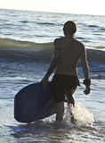 Surfer walks with his board Royalty Free Stock Images