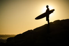 A surfer watching the waves. At sunset in Portugal Royalty Free Stock Photography