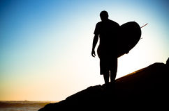 Surfer watching the waves Stock Photo