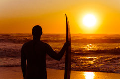 Surfer watching the waves Royalty Free Stock Images