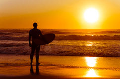 Surfer watching the waves Stock Photos