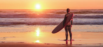 Surfer watching the waves Stock Photography