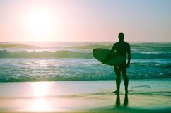 Surfer watching the waves. At sunset in Portugal stock photo