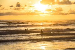 Surfer in the water at sunset, Indonesia. Surfer in the water at sunset, Yogyakarta, Indonesia Royalty Free Stock Images