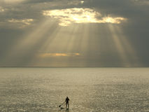 Surfer on the water. Surfers waiting for catching the wave stand up and paddle Royalty Free Stock Photos