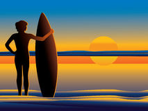 Surfer wathing the sunset Royalty Free Stock Image