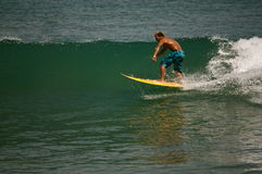 Surfer on the wave. Surfer riding the wave in Kuta Beach, Bali, Indonesia Stock Photography