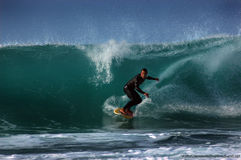 Surfer on a wave Stock Images