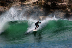 Surfer on a wave Stock Photos