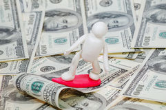 Surfer on the wave 3. Plasticine surfer on the wave of money stock photography