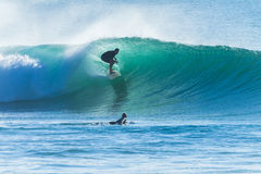 Surfer Wave Ride Silhouetted Stock Photos