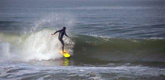 Surfer on wave at sandbar where the Santa Clara River empties into the Pacific Ocean at Ventura California U. Surfer on wave at sandbar where the Santa Clara stock image