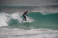 Surfer on a wave, Spain, October 2015 Royalty Free Stock Photo