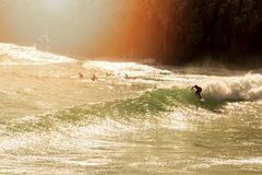 Surfer on the wave at sunset. Surfing - surfer on the wave at sunset Royalty Free Stock Image