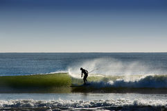 Surfer on the waves in the ocean and sprays Royalty Free Stock Photos