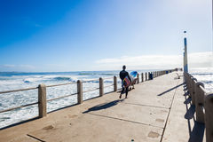 Surfer Waves Walking Pier Royalty Free Stock Photo