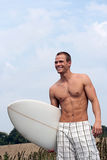 Surfer on the way to the beach Stock Photos
