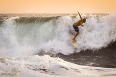 Surfer on wild Ocean Wave in Bali Stock Image