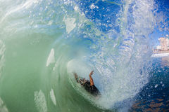 Surfer Crash Inside Hollow Wave Stock Image