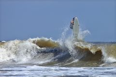Surfer wiping out Stock Image