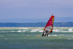 Free Surfer With Red Windsurf Surrounded With Waves - Lake Balaton Royalty Free Stock Image - 191208766