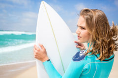 Surfer woman on the beach Stock Photography