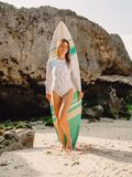 Surfer woman posing with surfboard. Beautiful surfer girl stock photos