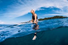 Free Surfer Woman Sit On Surfboard And Waiting Wave In Sea Royalty Free Stock Image - 164937426