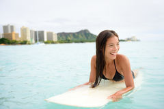 Surfer woman surfing on Waikiki Beach Hawaii Stock Image