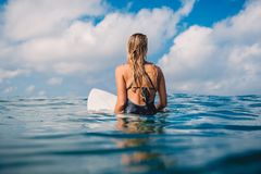 Surfer woman in swimwear with surfboard. Woman with surfboard in tropical ocean. stock image