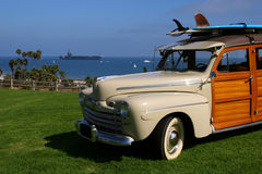 Surfer Woody Wagon And USS Reagan Royalty Free Stock Photos