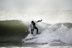 Surfer and wraparound wave Royalty Free Stock Images