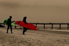 Surfers. On the beach Stock Photos