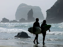 The surfers. Surfers on a california beach Royalty Free Stock Image