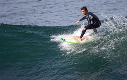 Surfers in action Stock Images