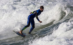 Surfers in action Stock Photos