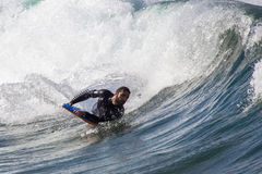 Surfers in action Stock Photo