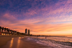 Surfers in Barcelona beach. Barceloneta Beach in Barcelona with colorful sky at sunrise Stock Photography