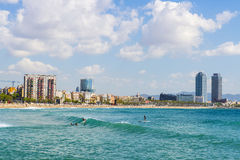 Surfers in Barcelona Stock Photography